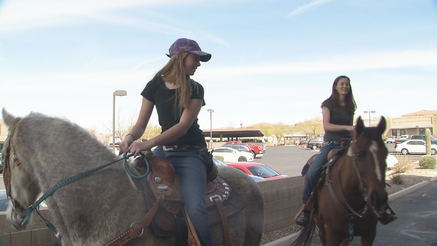 Aspen Cline and her mom, Tandy Cline, ride their horses through the drive-thru at Starbucks (Source: 3TV/CBS 5)
