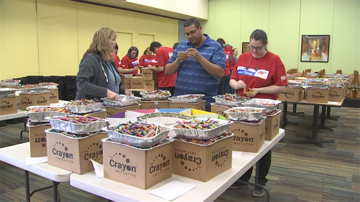 Volunteers help organize crayons before they get melted. (Source: 3TV/CBS 5)