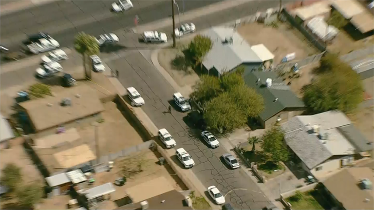 Phoenix police officers on scene of a shooting near 59th Ave. and Osborn Rd. (Source: 3TV/CBS 5 News)