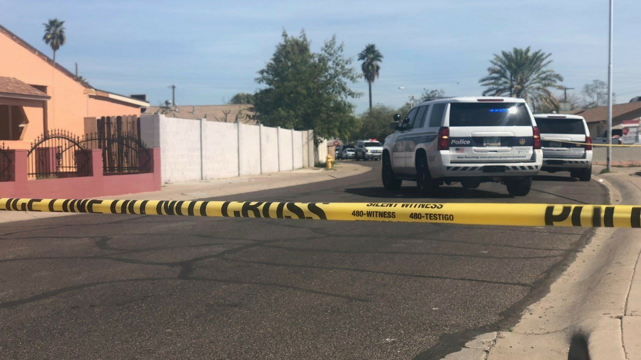 Phoenix police officers on scene of a shooting near Osborn and 59th Ave. Friday (Source: 3TV/CBS 5 News)