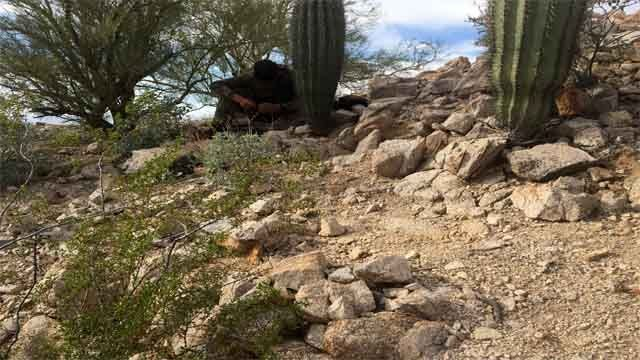 """This scout is living in a mountain range 40 miles south of Phoenix. He has a police scanner, two-way radios, cell phones and extra batteries. He is the """"eyes in the skies"""" for drug smugglers making their way north from Mexico. (Source: CBS 5 Investigates)"""