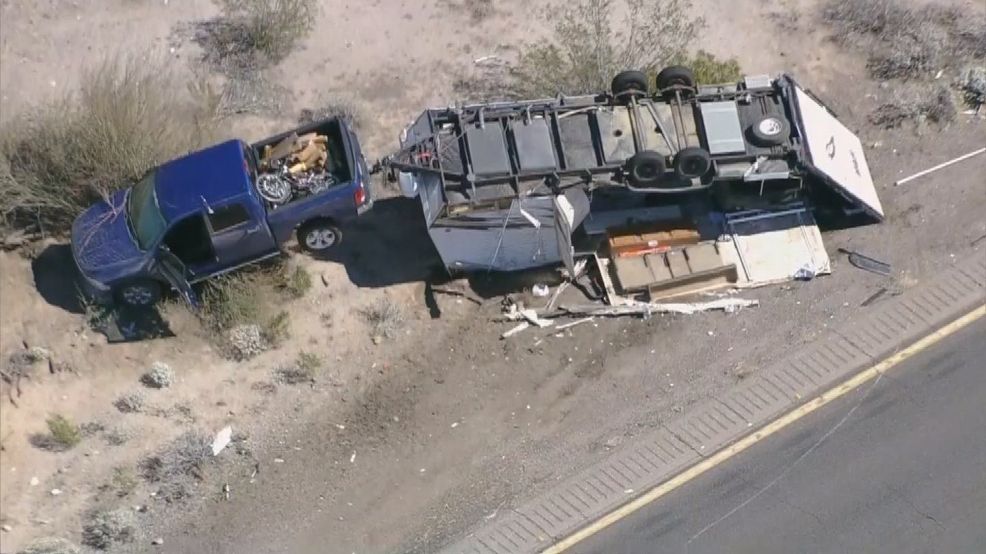 Pickup towing camper rolled over on I-10 near Sacaton.  (Source: 3TV/CBS 5 News)