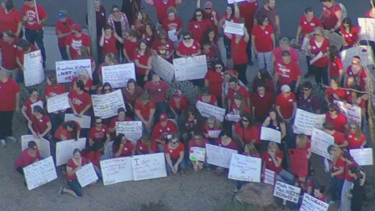 Teachers protest for better wages outside the KTAR studios where Gov. Ducey was being interviewed on March 12, 2018. (Source: 3TV/CBS 5 News)