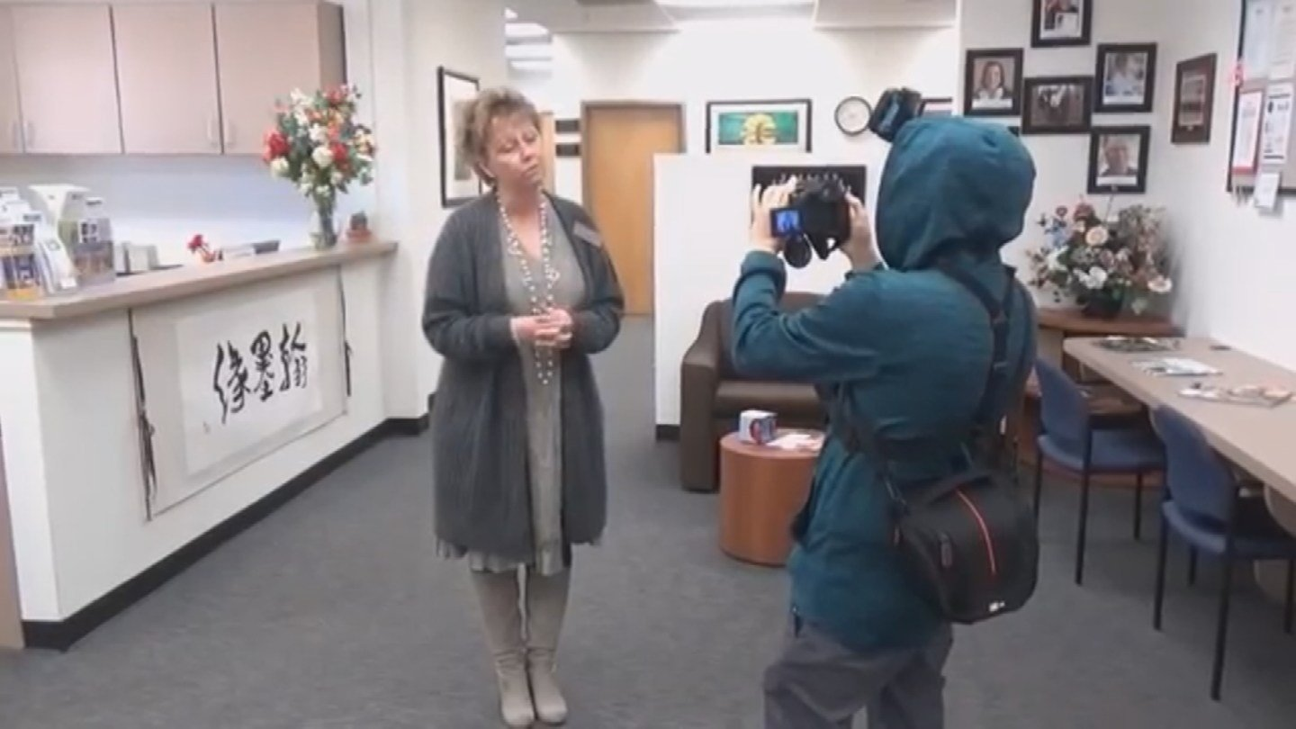 A member of 'Dragonfire Auditing' shoots video at a Cave Creek school. (Source: 3TV/CBS 5)
