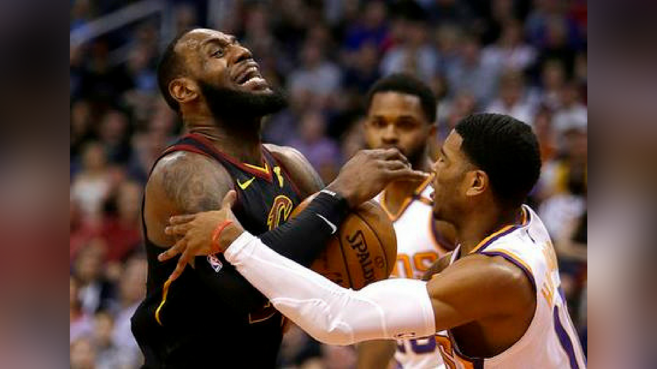 Cleveland Cavaliers forward LeBron James (23) gets fouled by Phoenix Suns guard Shaquille Harrison in the first half during an NBA basketball game, Tuesday, March 13, 2018, in Phoenix. (Source: AP Photo/Rick Scuteri)