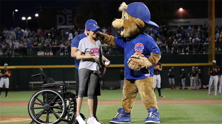 Las Vegas shooting survivor, Jovanna Calzadillas, threw out the first pitch at the first pitch at the March 13th Chicago Cubs Spring training game. (Source: Chicago Cubs)