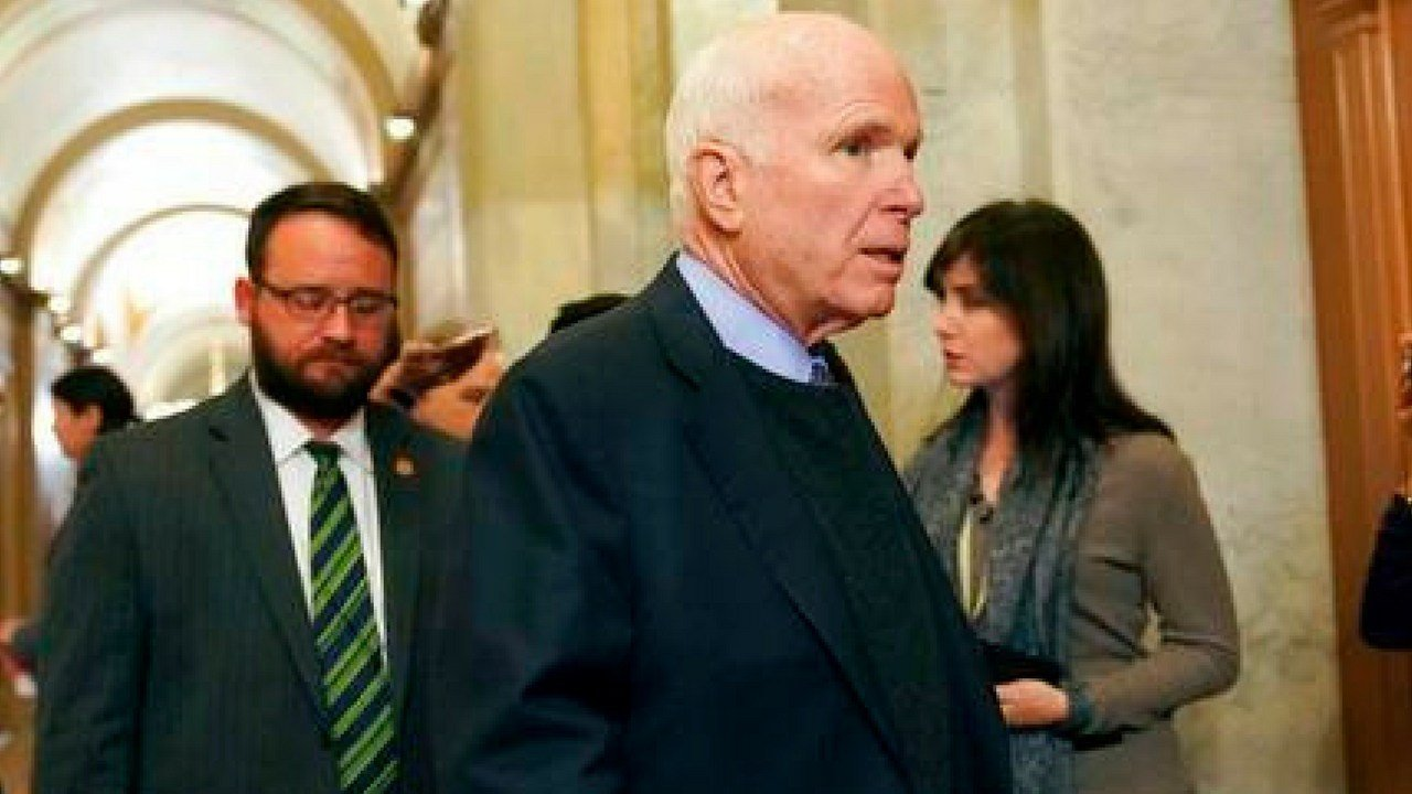 FILE - In this Nov. 13, 2017 file photo Sen. John McCain, R-Ariz., arrives on Capitol Hill in Washington. McCain continues to undergo treatment in Arizona, but Meghan McCain said it's possible her father could return to Washington by the summer. (AP Photo