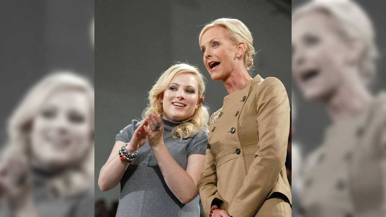 Meghan McCain on Thursday defended her father, who was a Vietnam prisoner of war, against an attack from Liz Cheney, who tried justifying the CIA's enhanced interrogation program under her father's vice presidency. (Source: CNN)