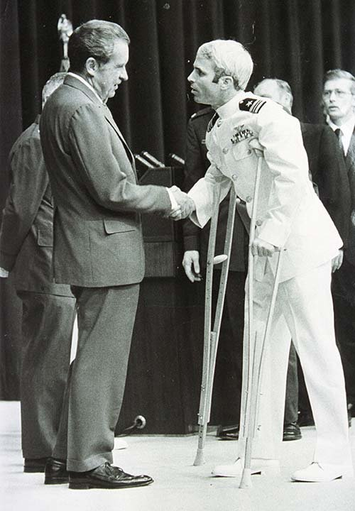 On May 24, 1973m Lt. Cmr. John McCain was welcomed by President Richard Nixon upon McCain's release after more than five years as a POW during the Vietnam War. (Source: Getty Images)
