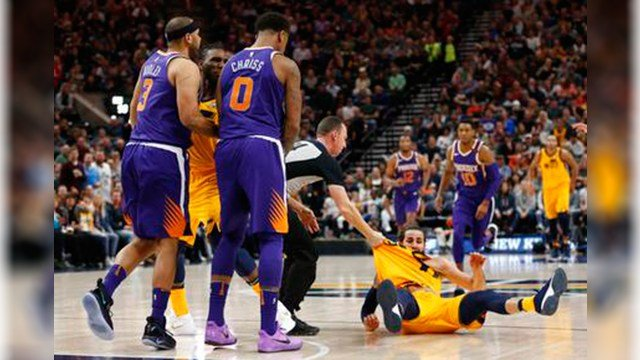 Phoenix Suns' Jared Dudley (3) and Marquese Chriss (0) stand nearby after shoving Utah Jazz's Ricky Rubio, right, to the court during the second of an NBA basketball game Thursday, March 15, 2018, in Salt Lake City. (Source: AP Photo/Rick Bowmer)