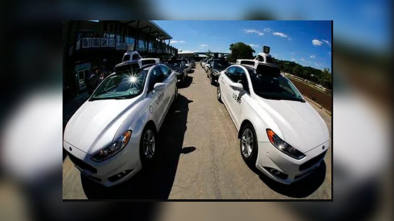 In this Monday, Sept. 12, 2016, photo, a group of self-driving Uber vehicles position themselves to take journalists on rides during a media preview at Uber's Advanced Technologies Center in Pittsburgh.  (Source: AP file photo)
