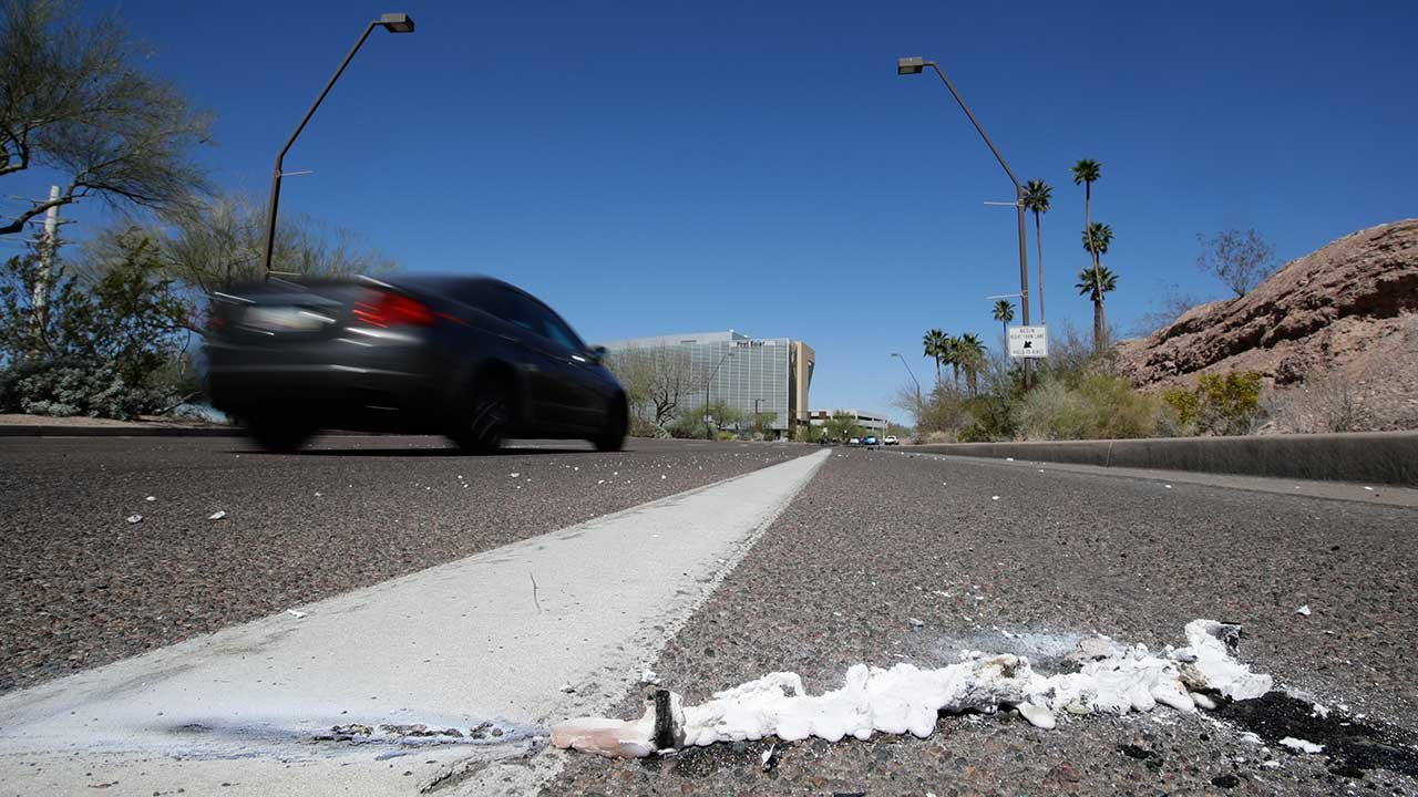 Cars go by the scene Monday, March 19, 2018, near where a pedestrian was stuck by an Uber vehicle in autonomous mode late Sunday night in Tempe. (Source: AP Photo/Chris Carlson))