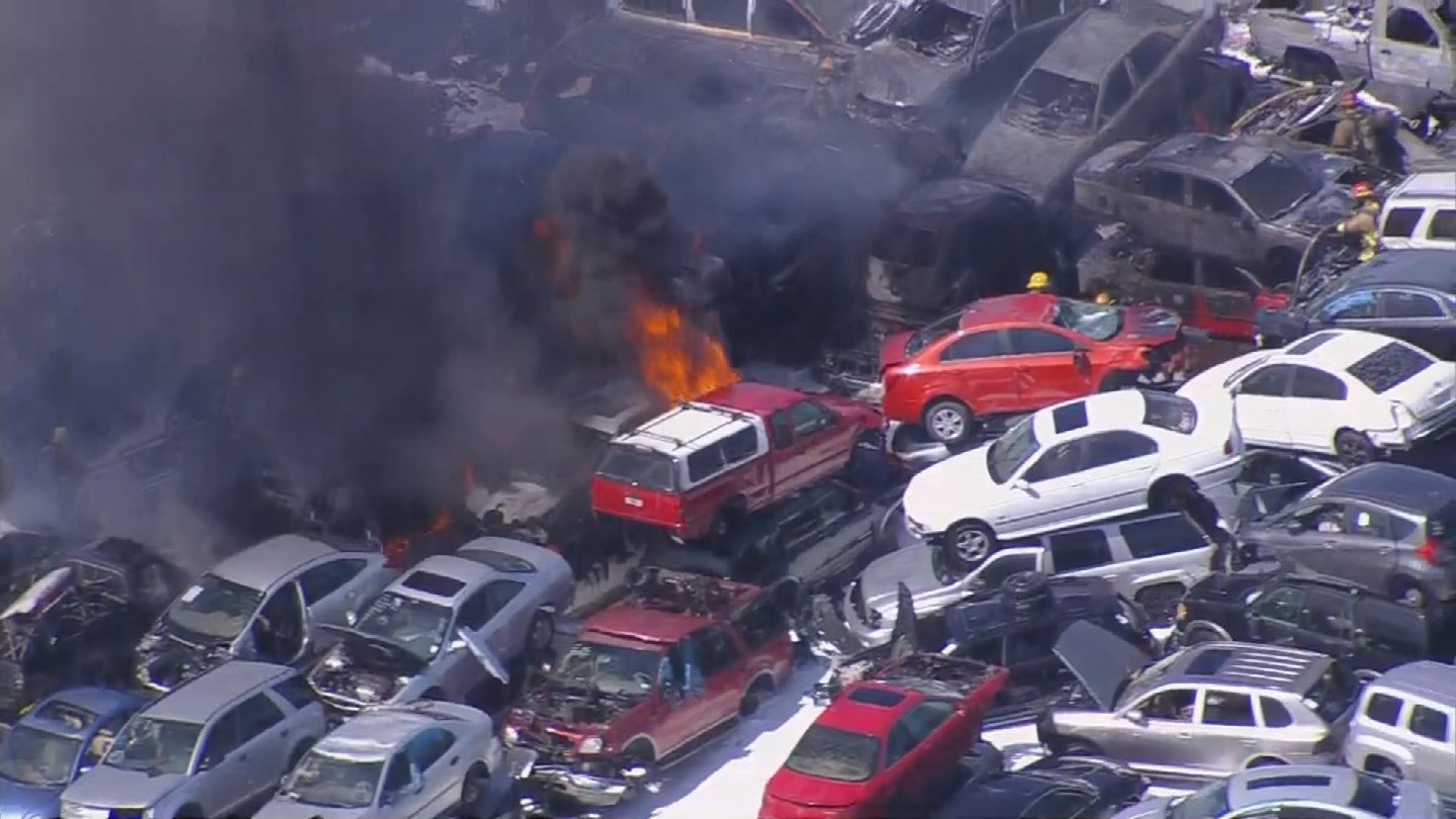 The fire was isolated to the packed cars in a scrapyard. (Source: 3TV/CBS 5 News)
