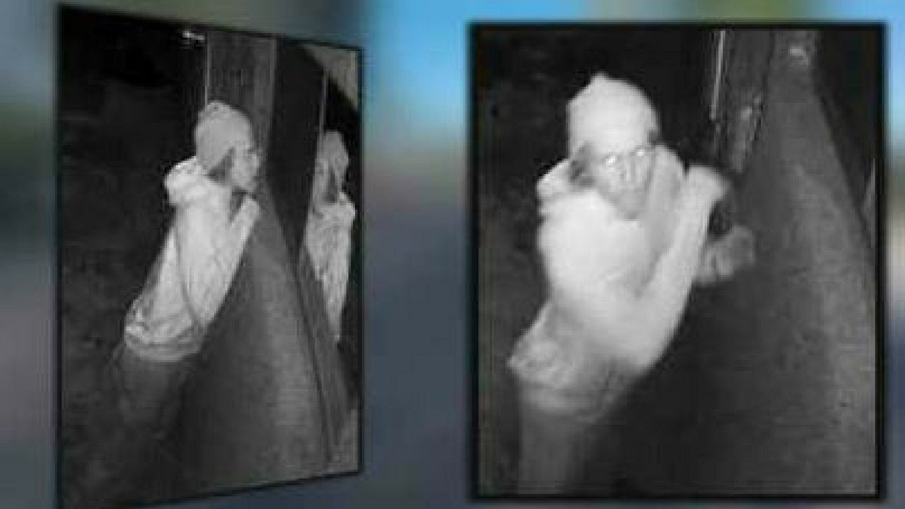 A peeper is caught on security camera looking into a bedroom window. (Source: 3TV/CBS 5 News)