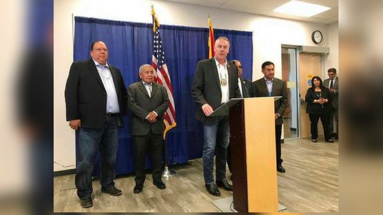U.S. Secretary of the Interior Ryan Zinke, at the podium, addresses the opioid crisis in Indian country in Scottsdale, Ariz., Monday, March 19, 2018. (AP Photo/Anita Snow)