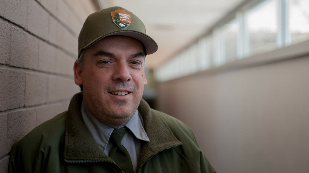 Bill Parker has been a park ranger at Petrified Forest National Park for 16 years. He studied paleontology at Northern Arizona University. (Photo by Jesse Stawnyczy/Cronkite News)