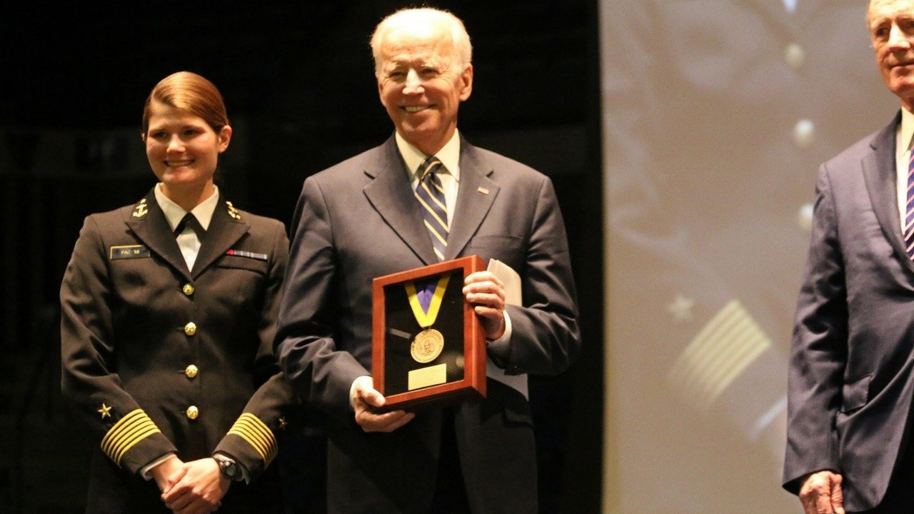 Former Vice President Joe Biden accepted the Naval Academy's Distinguished Graduate Award on behalf of Sen. John McCain, who remains in Arizona where he is being treated for am aggressive form of brain cancer. (Photo by Philip Athey/Cronikite News)