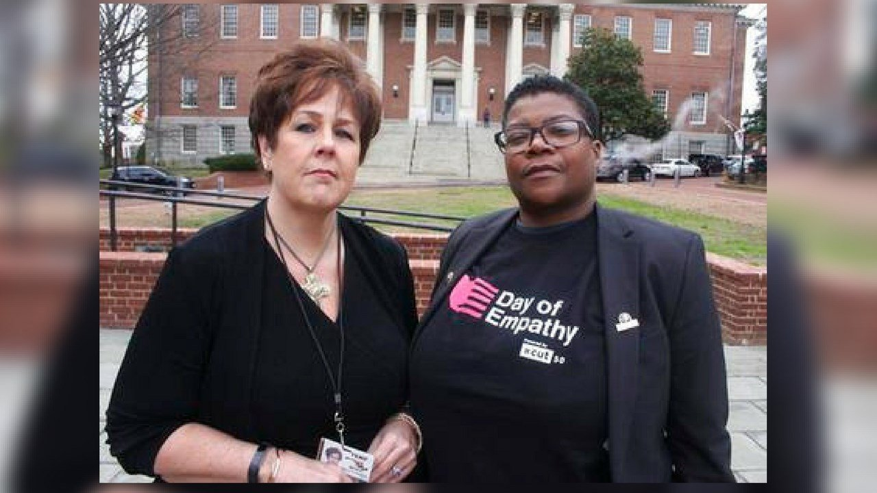 In this March 3, 2018 photo, Kimberly Haven, left, and Monica Cooper, two advocates for reforms in correctional facilities, pose for a photo in front of the Maryland State House in Annapolis, Md. (AP Photo/Brian Witte)