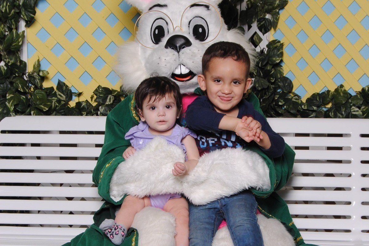 A photo of Christopher and Brooklyn sitting with the Easter bunny is the last picture of them together and alive. (Source: Amber Velasquez)