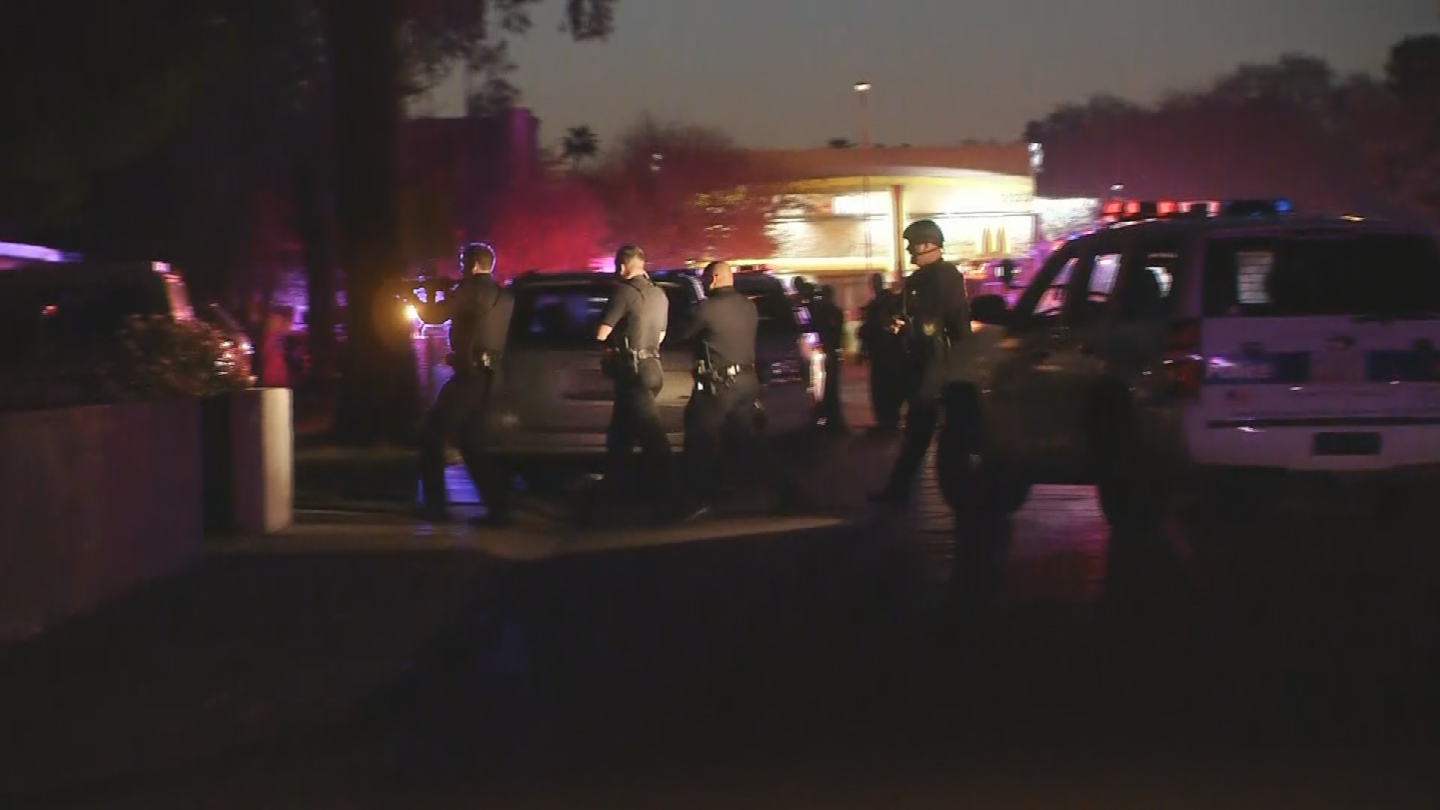 Police were clearing two houses after an officer-involved shooting early Wednesday morning. (Source: 3TV/CBS 5)