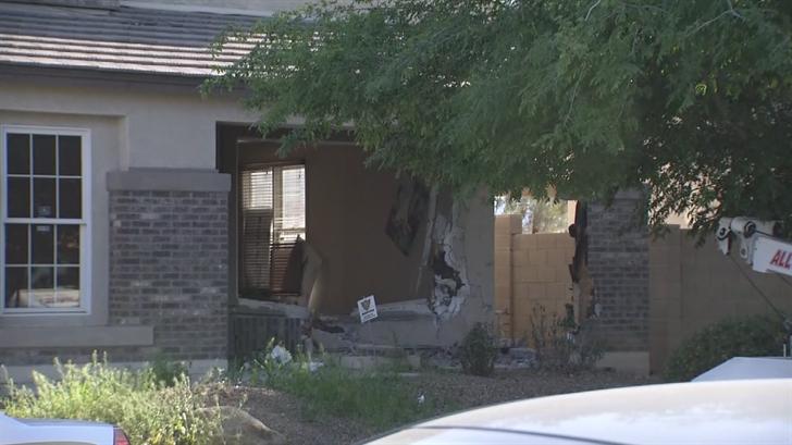 Police said a 23-year-old man crash an SUV into a south Phoenix home. (Source: 3TV/CBS 5)