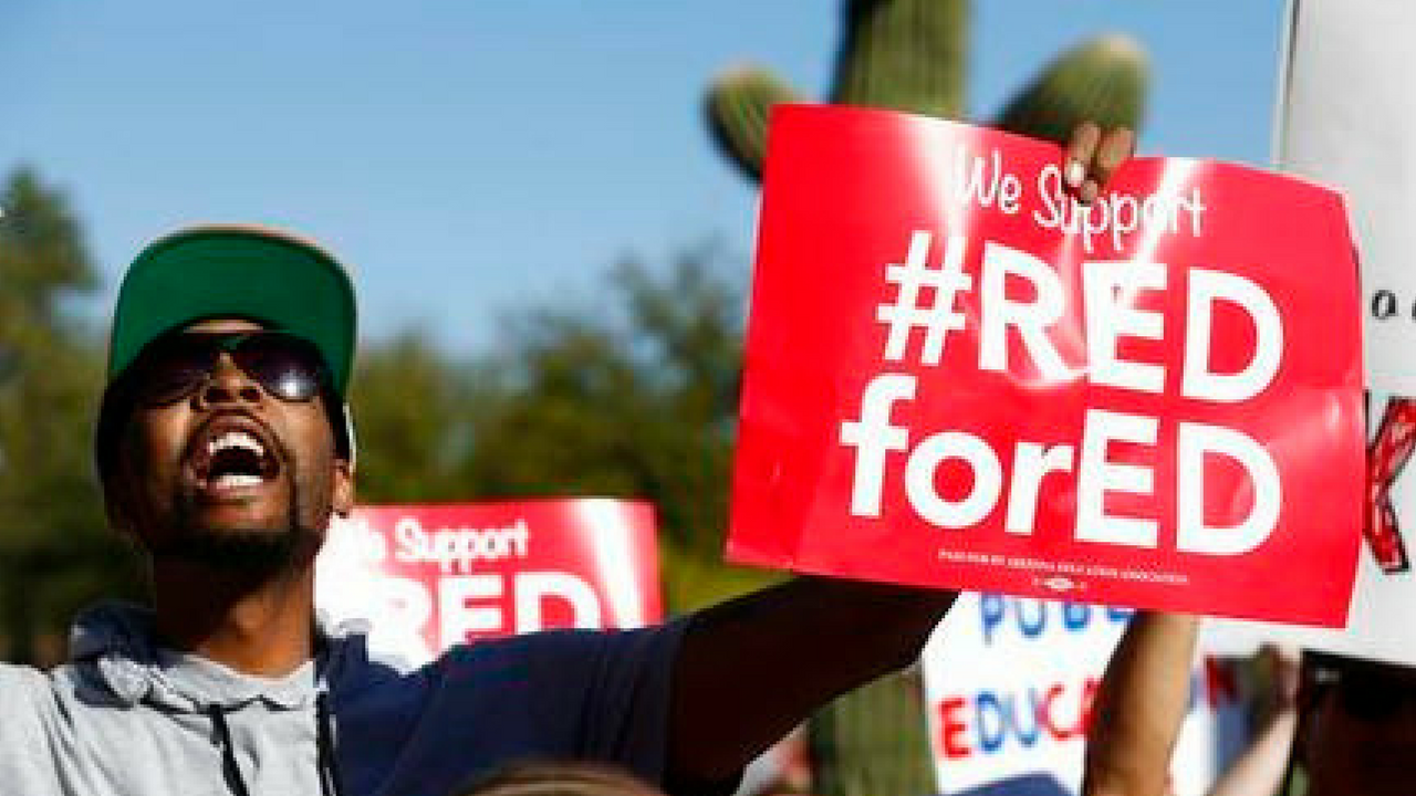 Arizona teachers and education advocates shouts as they march at the Arizona Capitol highlighting low teacher pay and school funding Wednesday, March 28, 2018, in Phoenix. (Source: AP Photo/Ross D. Franklin)