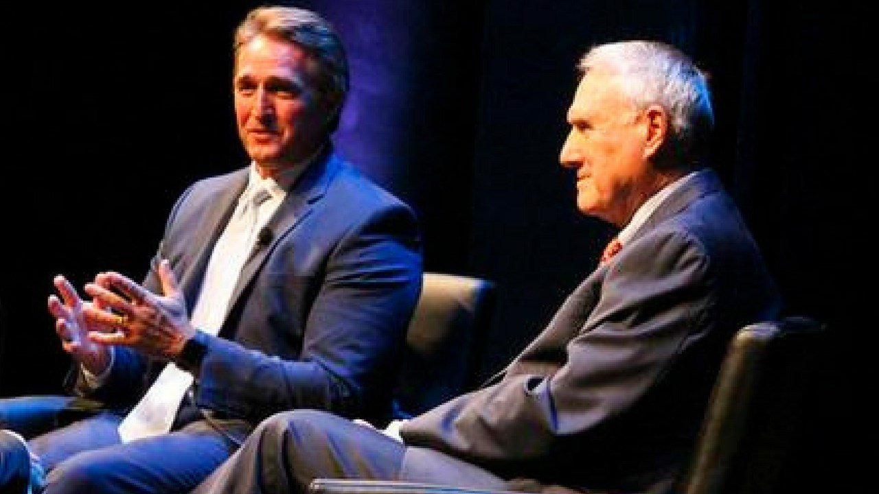 Sen. Jeff Flake, left, R-Ariz., and former Sen. Jon Kyl talk about the nature of politics and how bipartisanship is becoming more difficult, during a lecture at Arizona State University's Barrett Honors College. (AP Photo/Bob Christie)