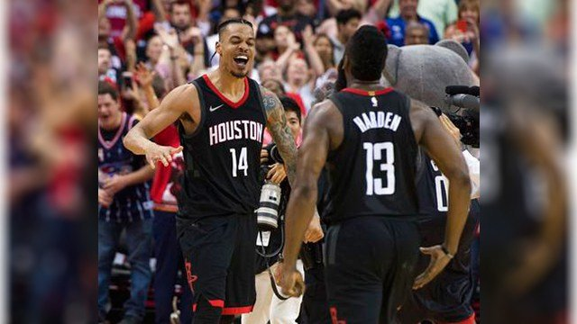 Houston Rockets guard Gerald Green (14) celebrates with James Harden (13) after hitting a shot at the buzzer to beat the Phoenix Suns in an NBA basketball game Friday, March 30, 2018, in Houston. (Source: AP Photo/George Bridges)
