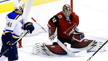 Arizona Coyotes goaltender Antti Raanta (32) makes the save in front of St. Louis Blues defenseman Robert Bortuzzo in the third period during an NHL hockey game, Saturday, March 31, 2018, in Glendale, Ariz. (Source: AP Photo/Rick Scuteri)