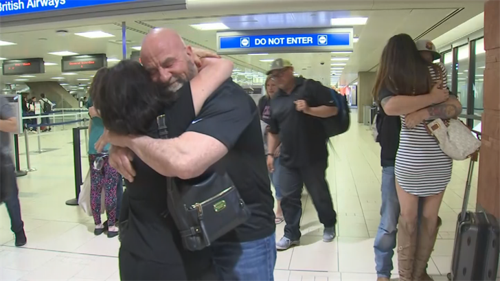 Families greet APS employees after they spent 11 weeks in Puerto Rico. (Source: 3 TV/CBS5)