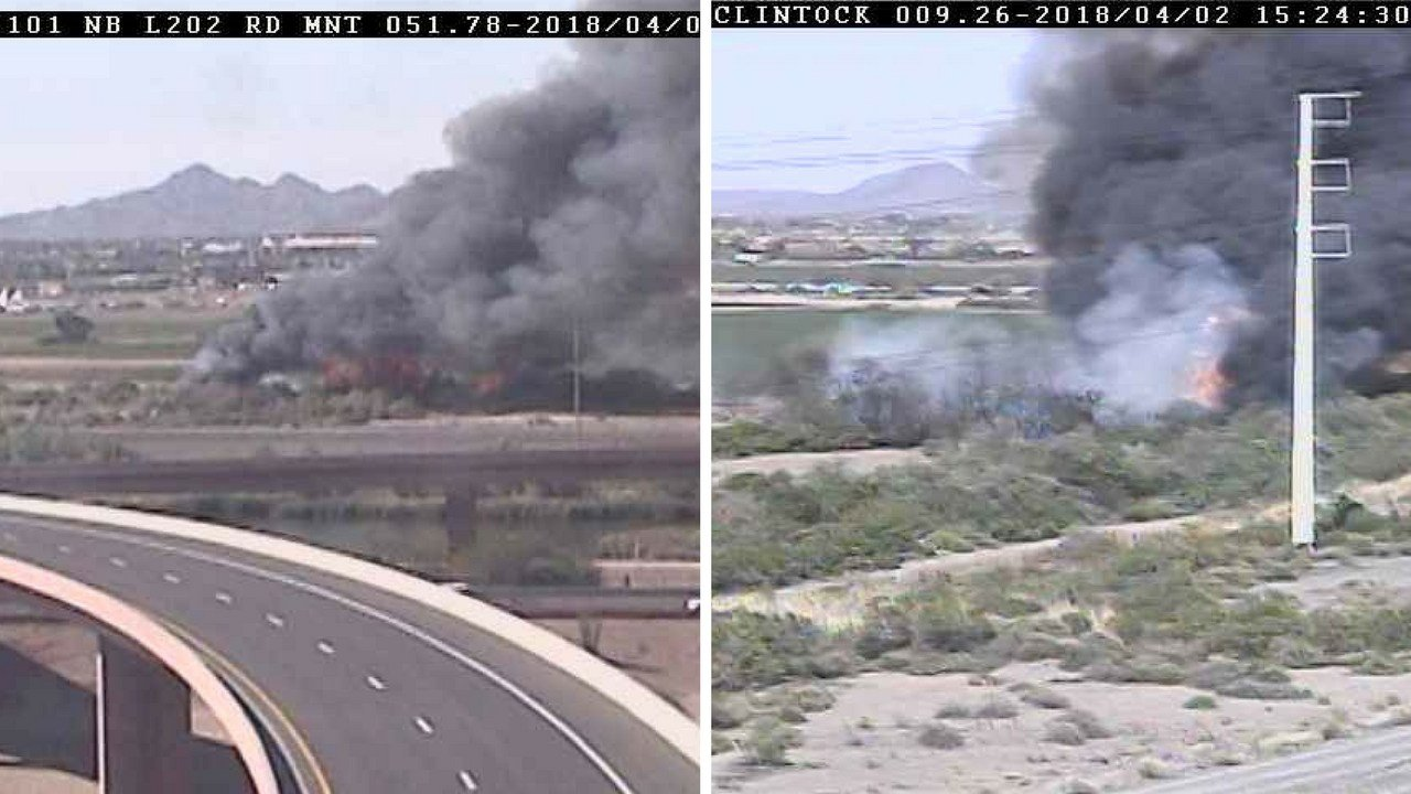 Smoke and flames from a brush fire near the L101 and L202 interchange. (Source: Arizona Dept. of Transportation camera)