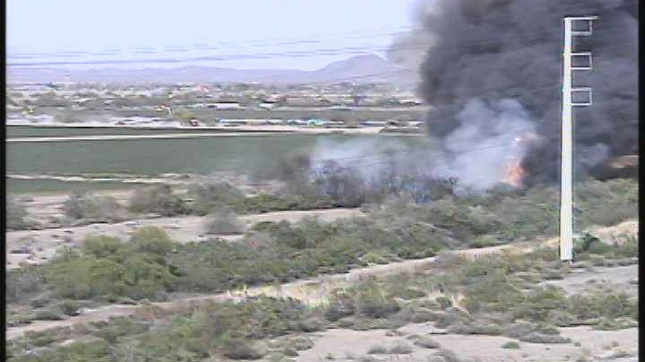 Brush fire burning Monday near the L101/L202 interchange in the east Valley. (Source: ADOT camera)