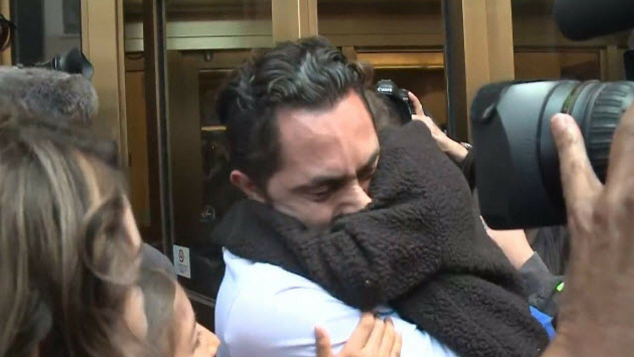 Tears and hugs greeted Fernando Carrillo  after he was released from immigration detention (Source: CBS)