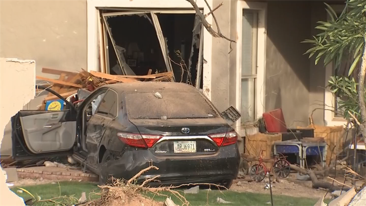 A man crashed his car into a house in Phoenix. (Source: 3TV/CBS 5)