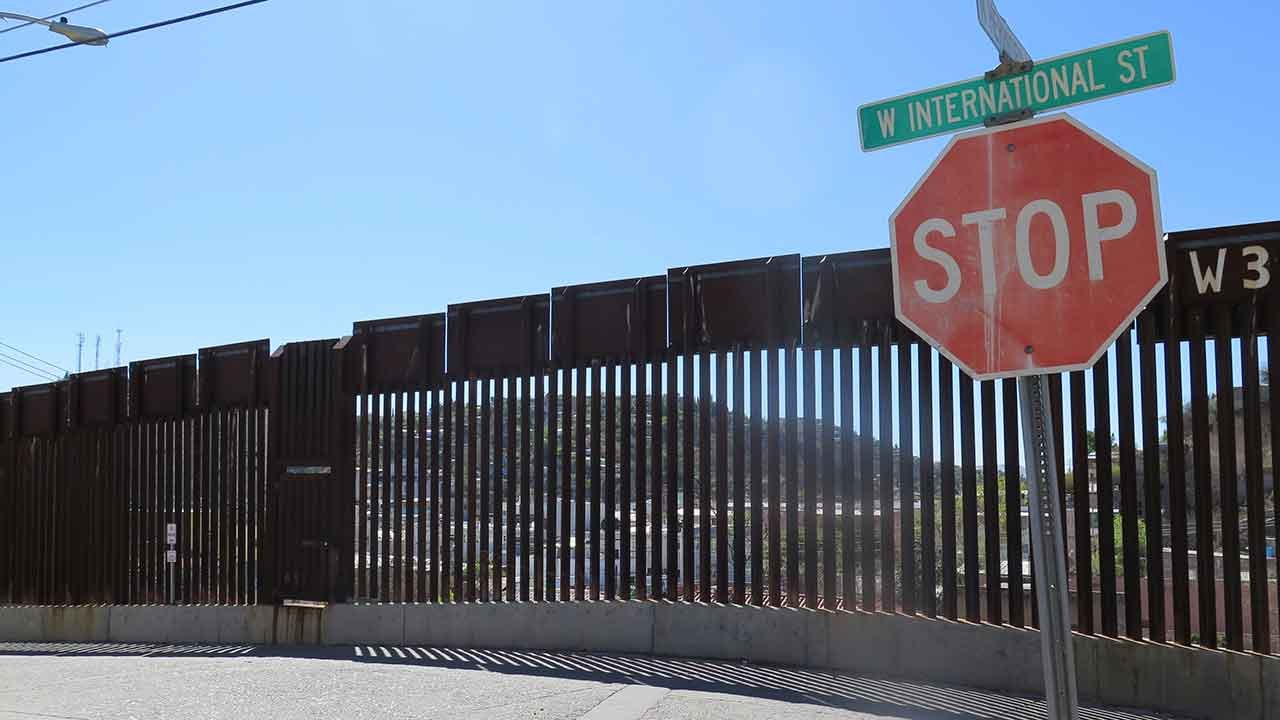This March 9, 2016, file photo, shows a stop sign in front of the international border fence in Nogales, Ariz. (Source: AP Photo/Astrid Galvan, File)