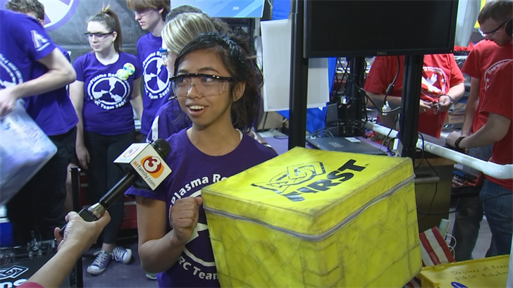 Kez Kelco with the cubes that the Plasma Robotic's robot is designed to move. (Source: 3TV/CBS 5)