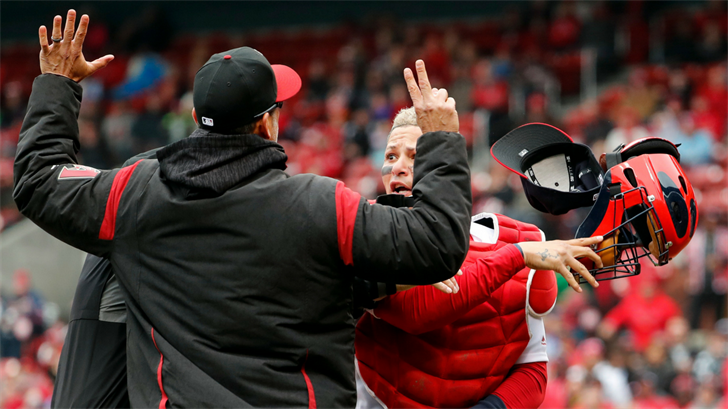 St. Louis Cardinals catcher Yadier Molina, right, throws off his mask as he argues with Arizona Diamondbacks manager Torey Lovullo during an altercation in the second inning on Sunday, April 8, 2018, in St. Louis. (Source: AP Photo/Jeff Roberson)