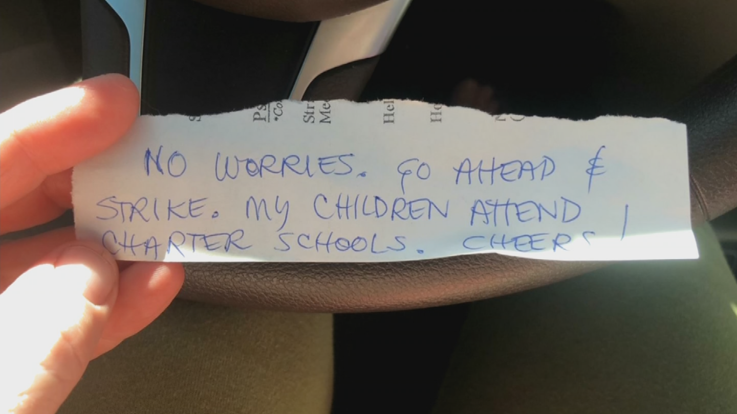 "When she sat down in the driver's seat, she noticed a note on the windshield from someone else. It read: ""No worries. Go ahead and strike. My children attend charter schools. Cheers!"" (Source: 3TV/CBS 5)"