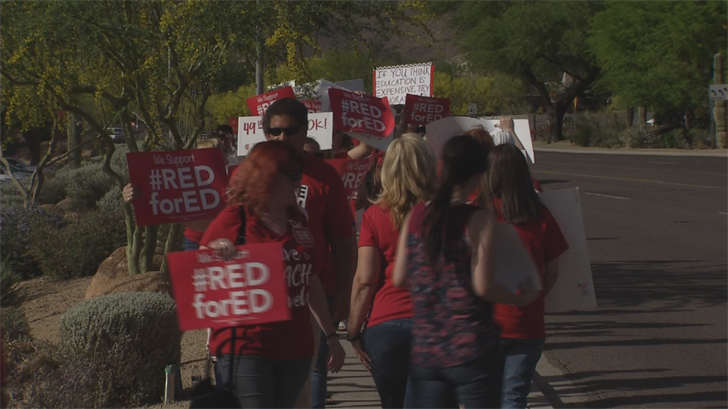 Teachers will be wearing red shirts and walking arm-in-arm at around a thousand schools across Arizona to show solidarity in their demand for higher salaries. (Source: 3TV/CBS 5)