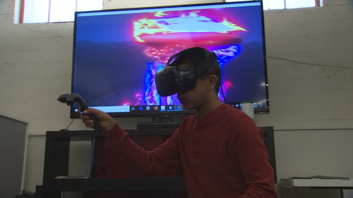 Ten children from the Free Arts for Abused Children of Arizona program painted in a virtual reality. (Source: 3TV/CBS 5)