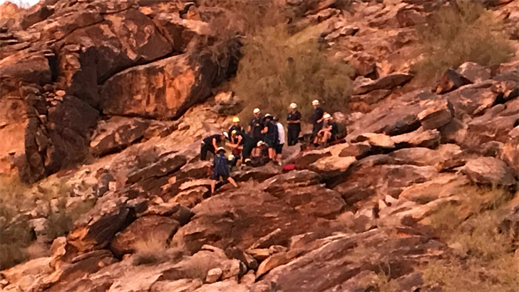Firefighters said the 29-year-old woman was not hurt but was trapped between four boulders about 50 feet up a ridge near the Kiwanis Trail. (Source: Phoenix Fire Department)