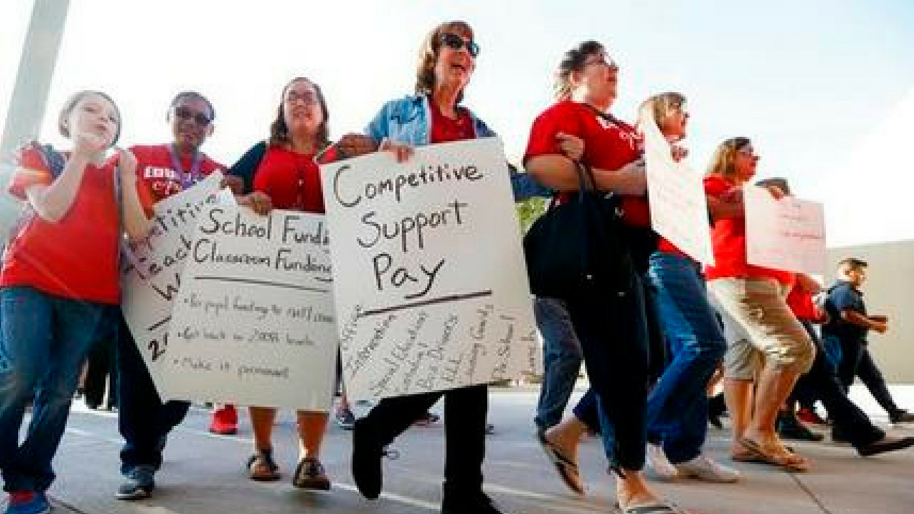 "FILE - In this April 11 2018 file photo, teachers at Tuscano Elementary School stage a ""walk-in"" for higher pay and school funding in Phoenix. (Source: AP Photo/Ross D. Franklin, File)"