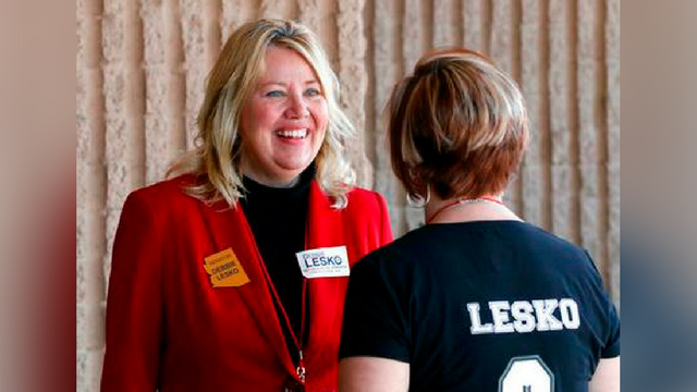 FILE - In this Jan. 27, 2018, file photo, Arizona State Rep. and U.S. Representative candidate Debbie Lesko speaks with a constituent during the meeting of the state committee of the Arizona Republican Party in Phoenix. (Source: AP Photo/Matt York, File)
