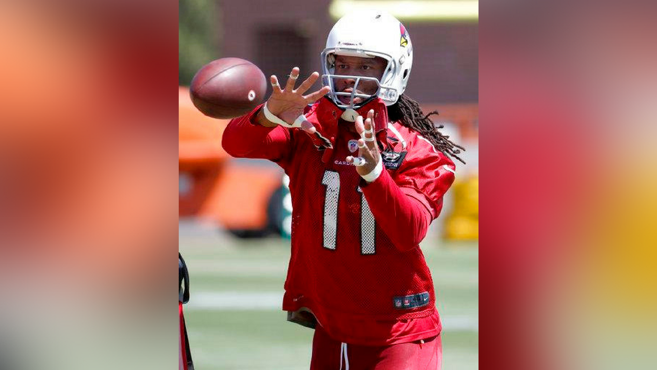 Arizona Cardinals NFL football player Larry Fitzgerald (11) runs drills during a voluntary team activity Tuesday, April 17, 2018, at the Cardinals' training facility in Tempe, Ariz.(Source: AP Photo/Matt York)
