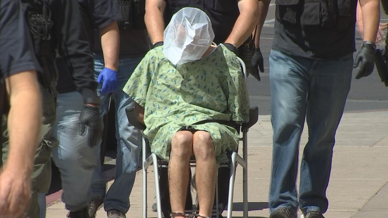 High-speed chase suspect Jairo Contreras wheeled into Phoenix Police HQ (Source: 3TV/CBS 5)