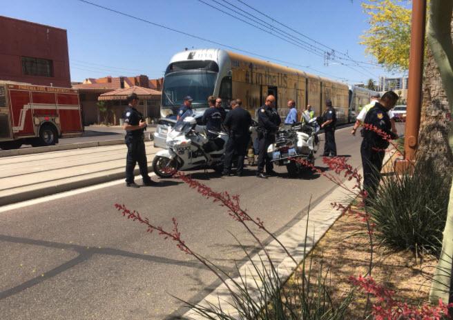 Car trying to cross light rail tracks struck by train (Source: 3TV/CBS 5)