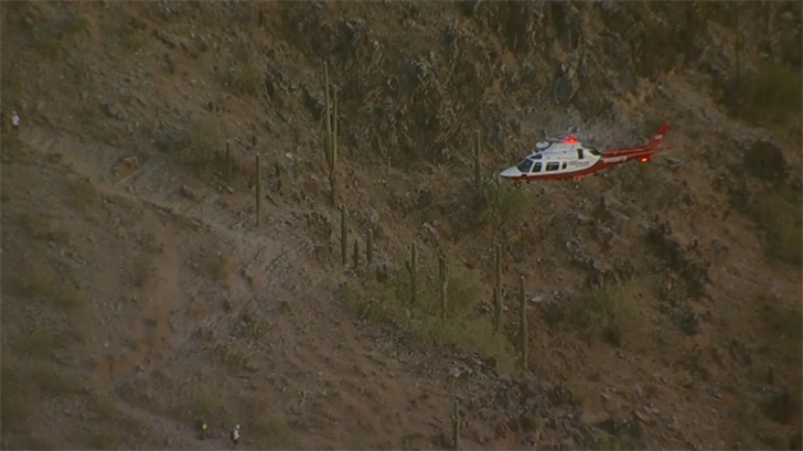 Firefighters used a helicopter to get a woman who injured her ankle off the mountain. (Source: 3TV/CBS 5)