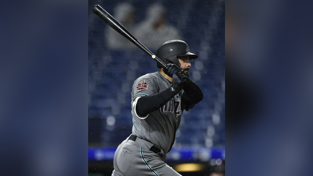 Arizona Diamondbacks' Alex Avila follows through after hitting a RBI single to score A.J. Pollock off Philadelphia Phillies' Victor Arano during the sixth inning of a baseball game, Tuesday, April 24, 2018. (Source: AP Photo/Derik Hamilton)