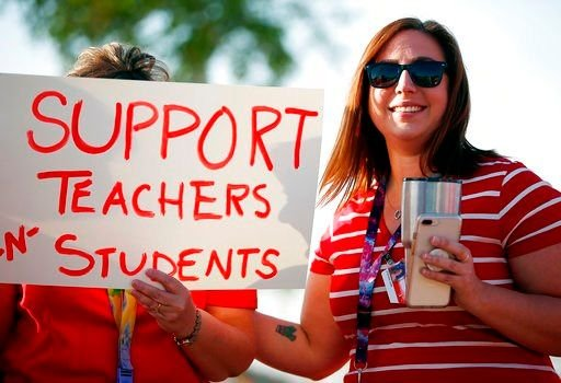 Educators who are among the lowest-paid in the U.S. have organized weeks of protests seeking raises and a boost in overall school funding, culminating in a vote for the first-ever statewide strike. (Source: AP Photo)