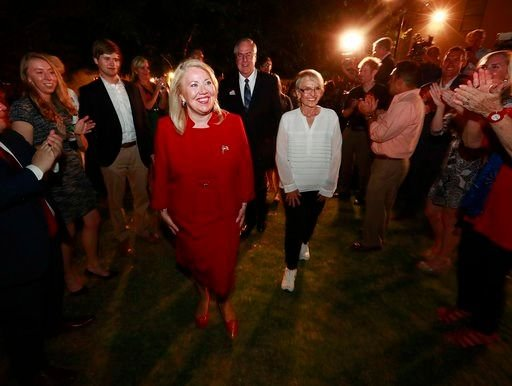 Republican U.S. Congressional candidate Debbie Lesko, front left, walks to the stage with former Arizona Gov. Jan Brewer after her congressional win, Tuesday, April 24, 2018. (Source: AP Photo/Matt York)